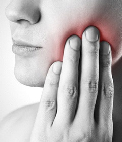 A person experiencing mouth pain.