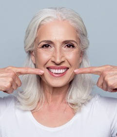 older woman pointing to teeth