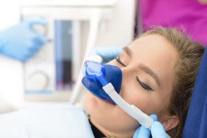 Woman getting nitrous oxide at dental office.