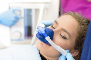 woman sleeping receiving sedation dentistry