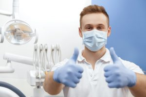 Dentist wearing personal protective equipment