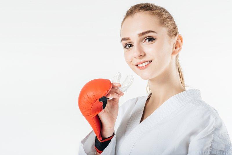 Woman holding a mouthguard